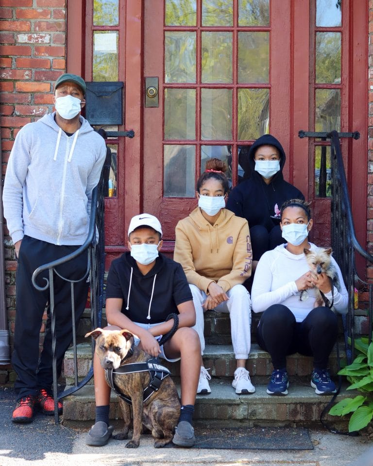 family is wearing masks